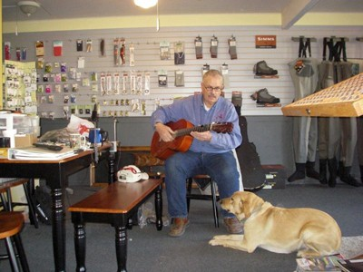 David D'Beaupre's dad was passing through and stopped to play guitar while others chatted in the shop.