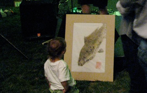 kid looking at carp print