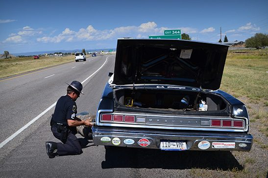 Cop helps replace Clyde's tire on the way to Bozeman, Montana.
