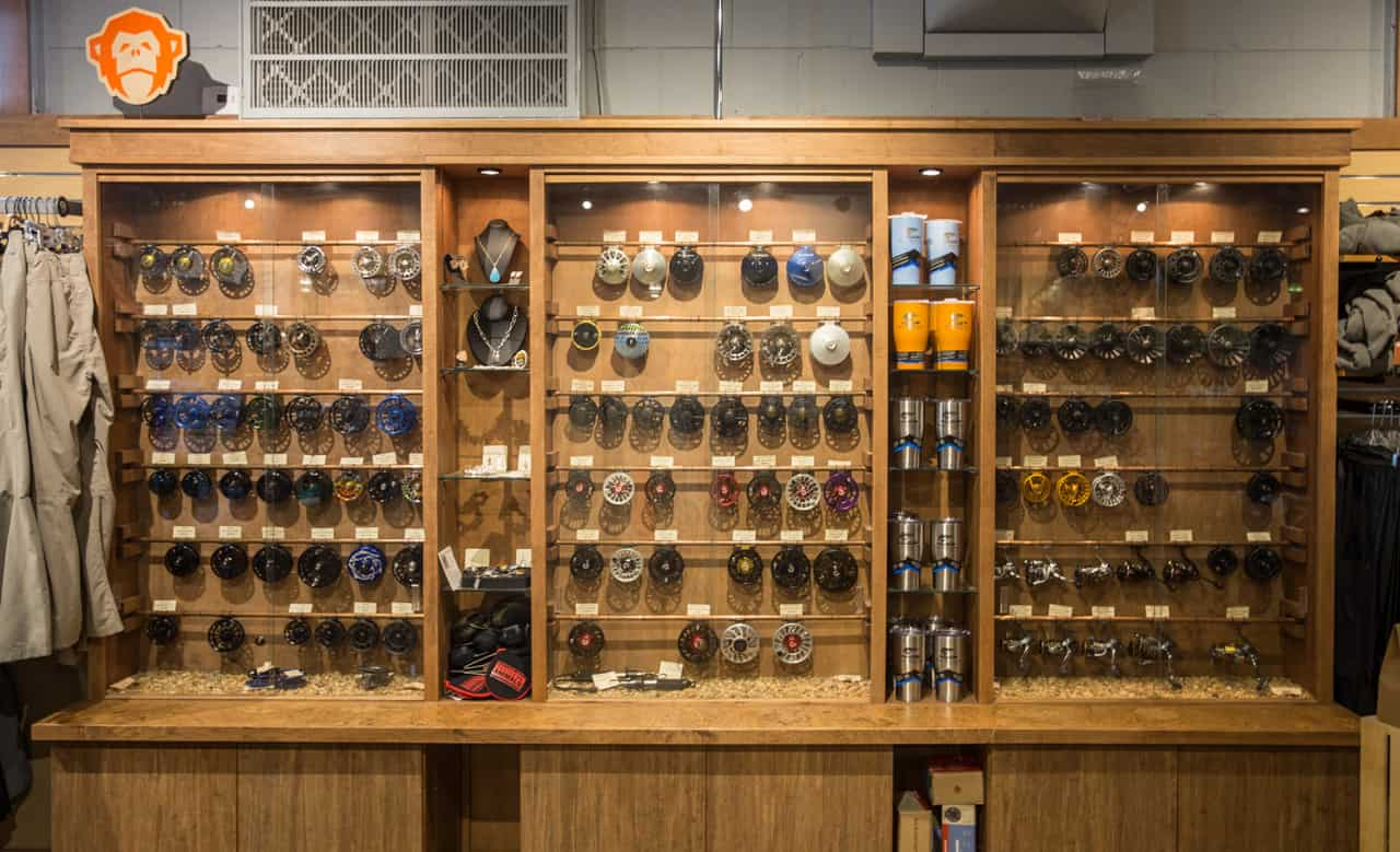 Fly reels are hung in a trophy case for easy access.