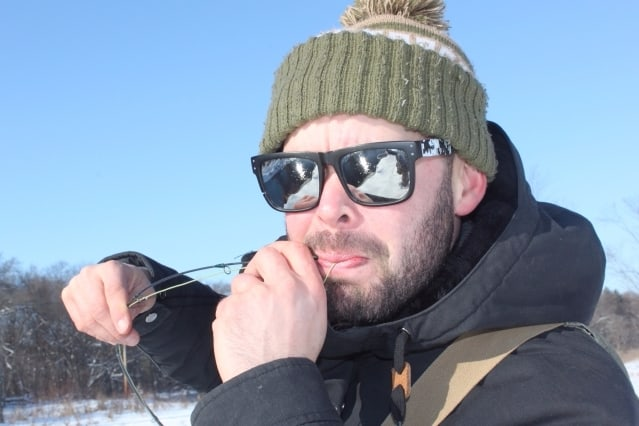 Ben Deices his flyrod - winter trout fishing