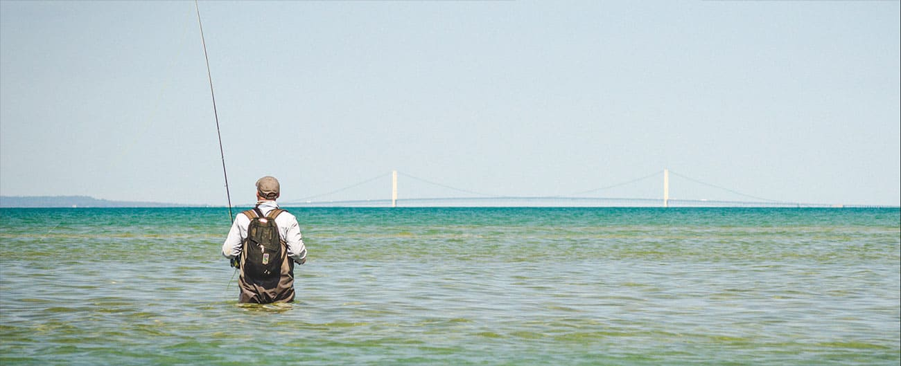 flats fishing, michigan-style. patience and a decent double-haul helps. mackinac bridge in the background