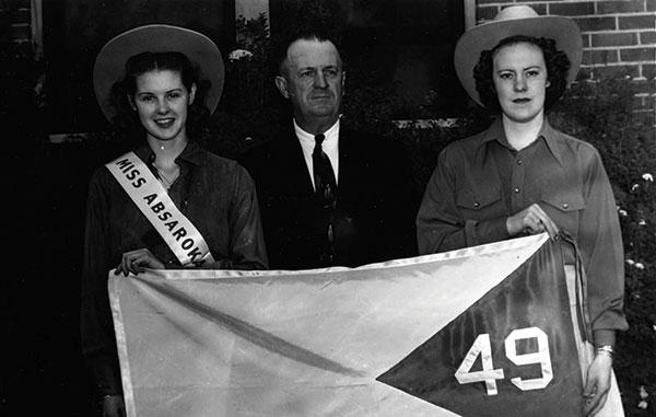 Political agitator A. R. Swickard (center), flanked by miss Absaroka, Dorothy Fellows, and her attendant, Esther Aspaas.