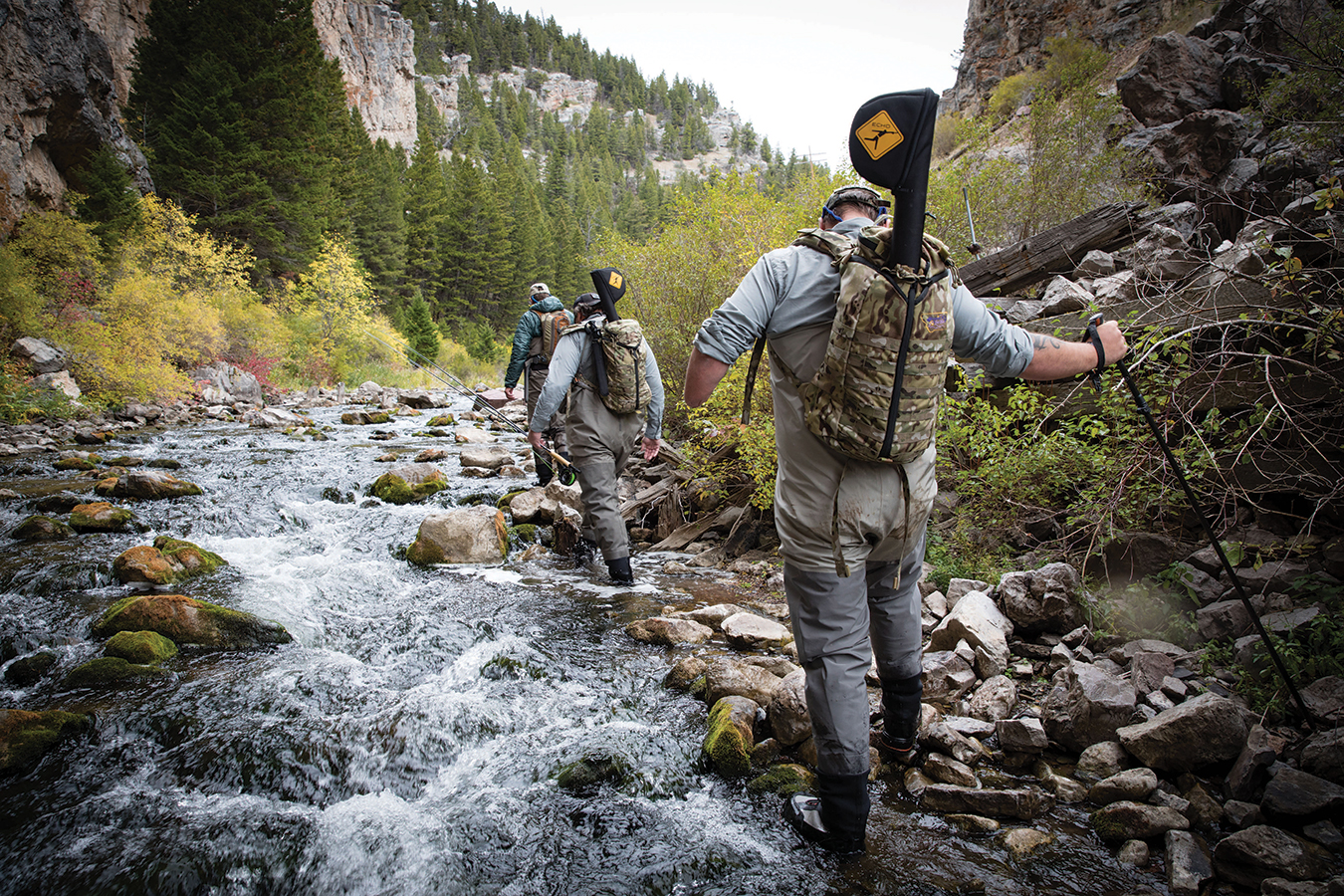 "TRAUMATICALLY INJURED IN THE SAME BLAST IN AFGHANISTAN IN 2012, NICHOLAS WILLIAMS AND JOHN HOSEA FOLLOW GUIDE GRANT GRIGSBY UP MONTANA'S LEGENDARY SIXTEENMILE CREEK AS PART OF WARRIORS AND QUIET WATERS FOUNDATION'S ""FISHING EXPERIENCE."""