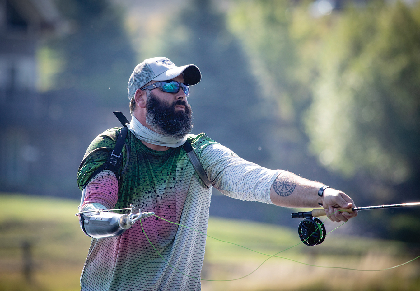 JOSHUA MCCART, AN ARMY VETERAN WOUNDED IN COMBAT, CASTS FOR TROUT ON MONTANA'S YELLOWSTONE RIVER.