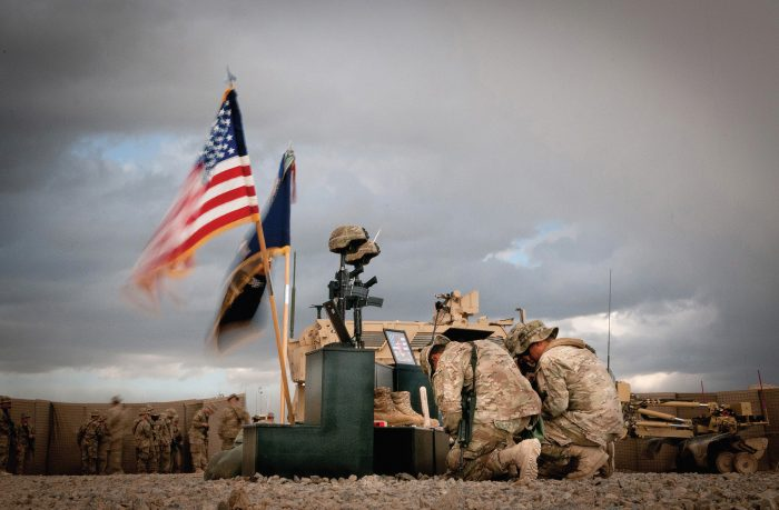 US ARMY PARATROOPERS WITH THE 82ND AIRBORNE DIVISION PAUSE BRIEFLY DURING COMBAT OPERATIONS IN AFGHANISTAN TO MOURN THE LOSS OF TWO OF THEIR OWN.