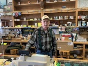 Bob Jacklin behind the counter of his shop